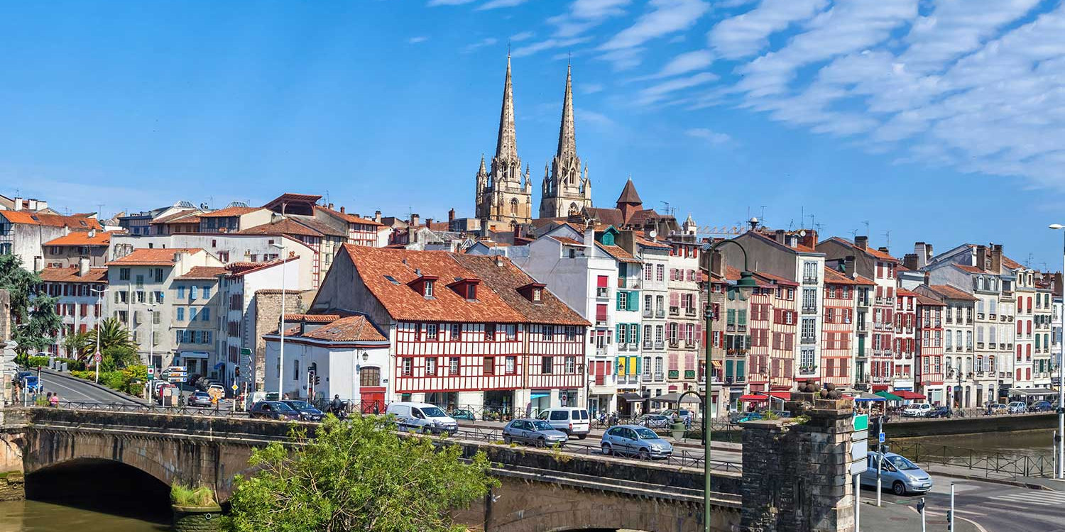 Panorama of Bayonne with bridge Pont du Genie across the Nive river on the front view